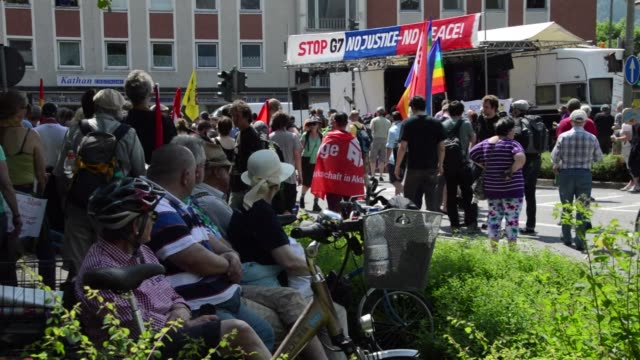 hundreds of people rallied saturday in germany's mountain resort town of garmisch partenkirchen to protest against the g7 to be held at the nearby... - garmisch partenkirchen stock videos and b-roll footage