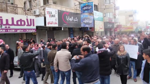 hundreds of people take part in a demonstration on march 15 2019 in jordan's northern irbid province to express solidarity with palestine amid... - ヨルダン点の映像素材/bロール