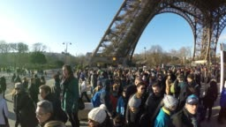 Hundreds of people visiting Eiffel Tower at winter time in Paris, France