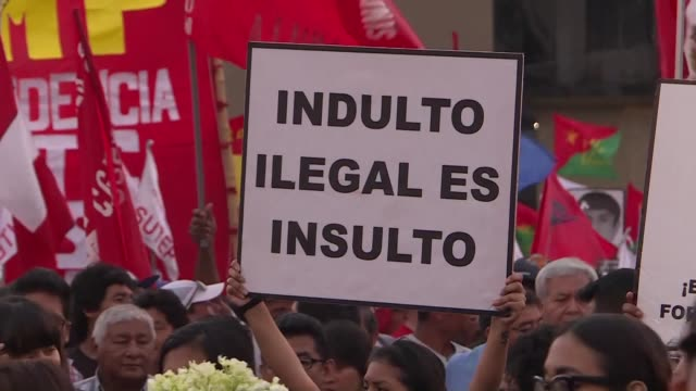 Hundreds of Peruvians take to the streets of Lima to protest against corruption and President Pedro Pablo Kuczynski granting a pardon to former head...