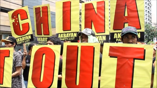 hundreds of philippine activists accuse china of gunboat diplomacy demonstrating at a noisy manila protest against the asian giants moves to stake... - south china sea stock videos & royalty-free footage