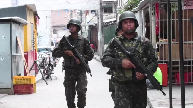hundreds of police and soldiers swept into impoverished favela neighborhoods in rio de janeiro early friday where violence is on the rise and a... - army stock videos & royalty-free footage