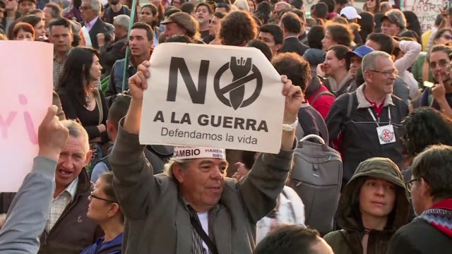 Hundreds of protesters gather in Bogota to defend the historic peace pact between Colombia and the FARC rebel group after negotiators warned the...
