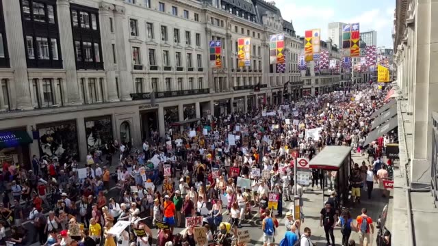 Hundreds of protesters gather on Regent Street in London to march against President Donald Trump's state visit to the UK