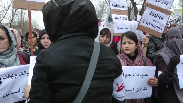 hundreds of protesters shouting down with ignorance urge the afghan government to bring to justice the killers of a woman lynched by a mob for... - lynching stock videos & royalty-free footage