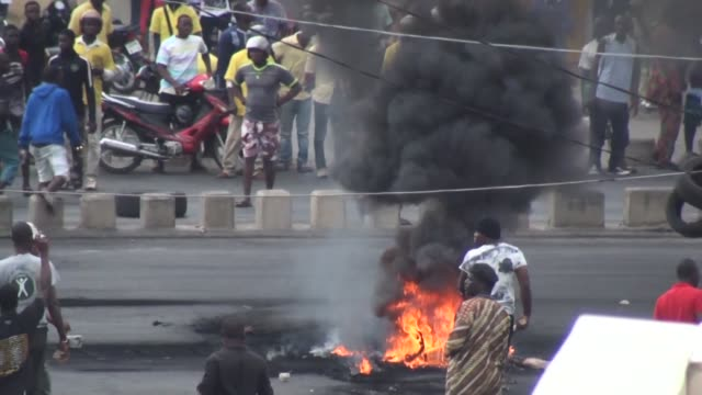 hundreds of protesters take to the streets of cotonou economic capital of benin in unrest that follows a controversial election held without a single... - benin stock videos and b-roll footage