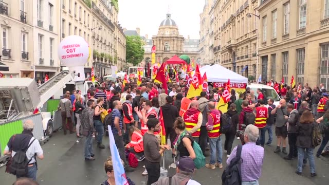 hundreds of rail workers protest in front of the french senate in paris just days before lawmakers vote on the rail reforms - governmental occupation stock videos & royalty-free footage