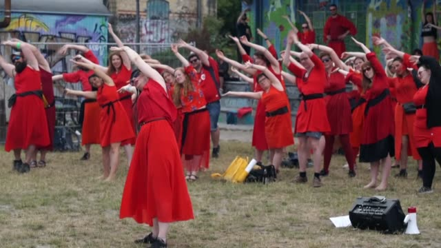 hundreds of red clad fans of british singer kate bush stage flash mobs in berlin as they reenact her classic hit wuthering heights - flash mob stock videos and b-roll footage