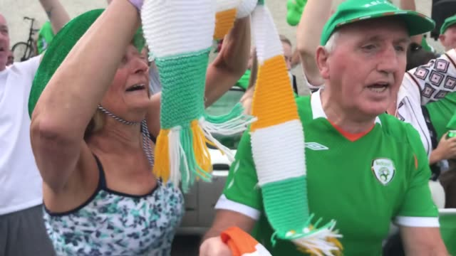 hundreds of republic of ireland fans gather at walkinstown roundabout in dublin to celebrate the life of jack charlton at 1230 as his funeral in... - jack charlton stock videos & royalty-free footage