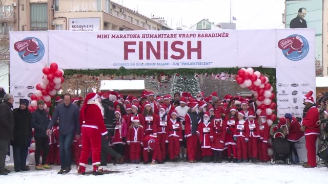 hundreds of runners dressed in santa claus costumes race through pristina's streets in a mini marathon raising money for families in need during the... - pristina stock videos and b-roll footage