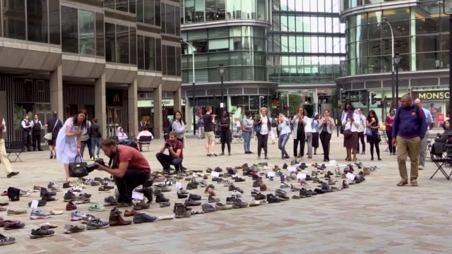 hundreds of shoes are being displayed outside westminster cathedral for pope francis' refugee campaign. the campaign, led by catholic charities cafod... - westminster cathedral stock videos & royalty-free footage