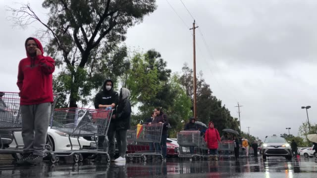 hundreds of shoppers wait in line in the rain to enter a costco wholesale store during 'panic buying' as the coronavirus spread continues on march 14... - social distancing stock videos & royalty-free footage