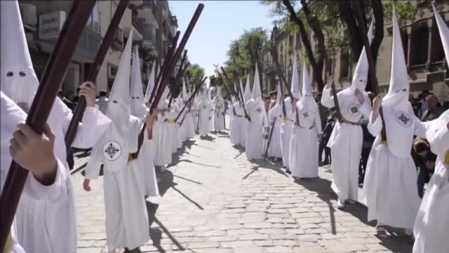 hundreds of spectators gather in seville to watch the religious procession marking holy week in the southern spanish city - holy week stock videos & royalty-free footage