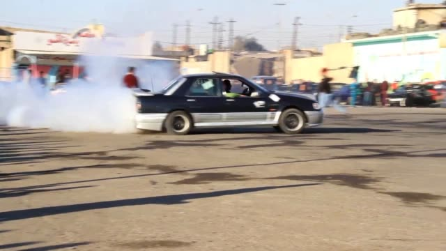 hundreds of speed cars lovers gathered in eastern mosul in the north of iraq on friday to participate in a free style drift show organised by... - mosul stock videos and b-roll footage