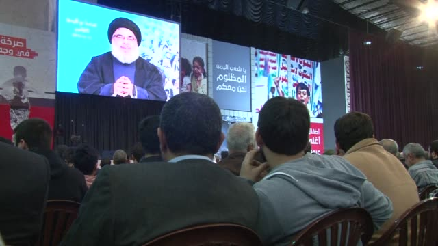 hundreds of supporters of lebanon's proiran movement hezbollah gathered in beirut on friday to listen to its leader hassan nasrallah give a televised... - television show stock videos & royalty-free footage