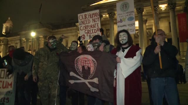 hundreds of supporters of the anonymous movement wearing masks gather in trafalgar square in london ahead of the million mask march on guy fawkes... - anonymous stock videos and b-roll footage
