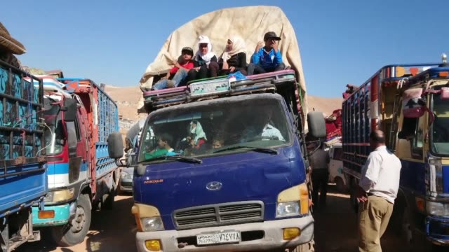 hundreds of syrian refugees most of them farmers leave lebanon from the city of arsal in the bakaa valley on the eastern border with syria for their... - lebanon country stock videos & royalty-free footage