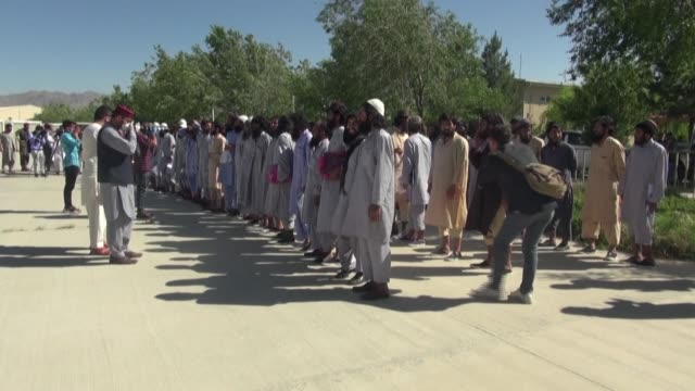 hundreds of taliban prisoners are released from bagram jail near kabul as part of a pledge by the government to free up to 2000 insurgent prisoners... - bagram video stock e b–roll