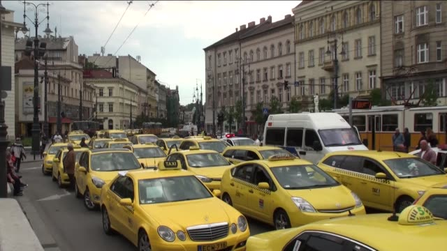 hundreds of taxi drivers drive through the elisabeth bridge as they protest against the uber application in budapest capital city of hungary on may... - széchenyi chain bridge stock videos and b-roll footage
