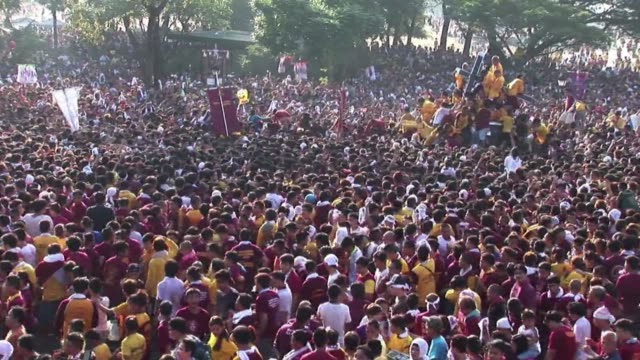 Hundreds of thousands of barefoot devotees pour into Manila for one of the world's biggest Catholic parades honouring an ebony statue of Jesus Christ...