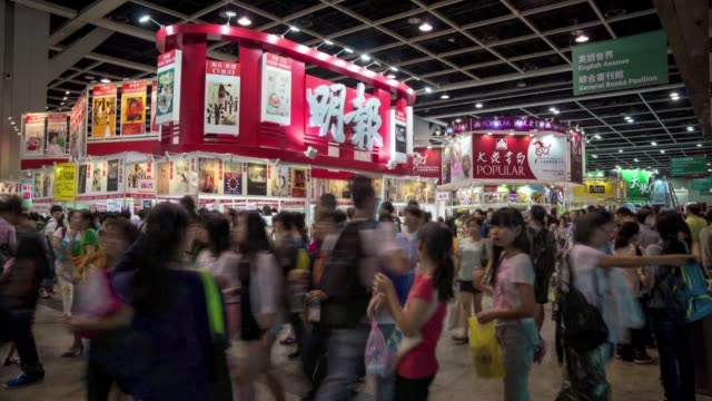 hundreds of thousands of book lovers flock to the hong kong book fair a seven day show packed with everything from cute cartoons to cutting edge... - satire stock videos & royalty-free footage