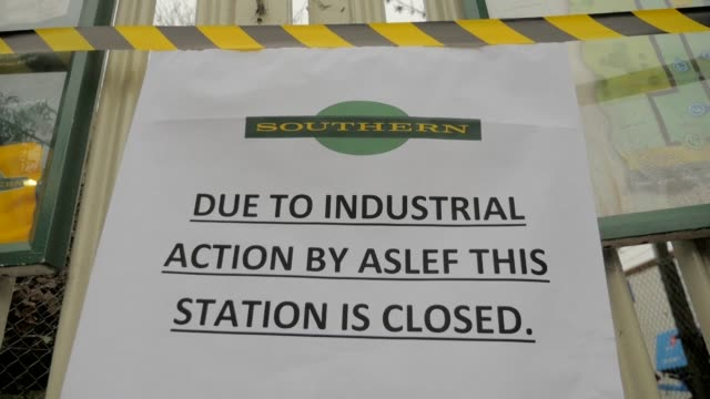 hundreds of thousands of commuters are left stranded for the third day this week after staff on southern rail which runs trains from southern england... - strike industrial action stock videos & royalty-free footage