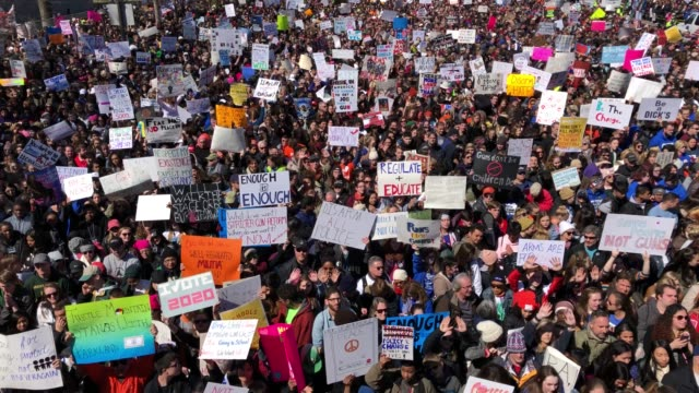 vídeos de stock, filmes e b-roll de hundreds of thousands of demonstrators including students teachers and parents are expected to gather for the antigun violence rally spurred largely... - marchando