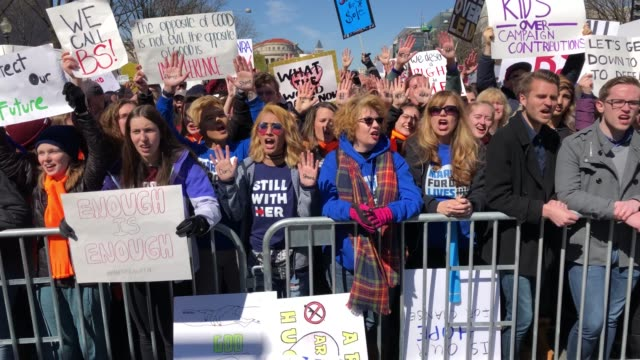 hundreds of thousands of demonstrators, including students, teachers, and parents are expected to gather for the anti-gun violence rally, spurred... - march for our lives stock videos & royalty-free footage