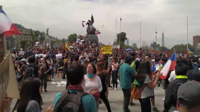 hundreds of thousands of demonstrators took to the streets here friday to protest the high cost of living and health services more than 800000... - chile stock videos and b-roll footage