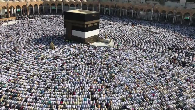 Hundreds of thousands of Muslim pilgrims perform the last Friday prayer around the Kaaba in Mecca's Grand Mosque ahead of the upcoming Eid alAdha on...