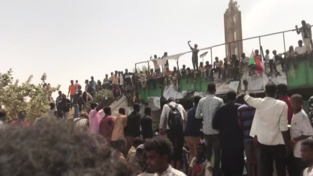 hundreds of thousands of people have been taking to the streets of the capital khartoum to celebrate ousting of 30year rule of sudan's president omar... - coup d'état stock videos & royalty-free footage