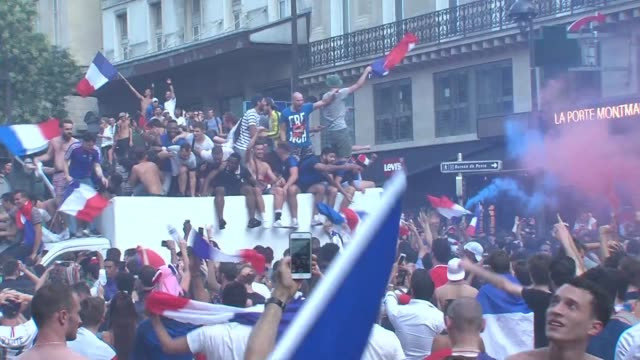 hundreds of thousands of people invade the streets of paris after france's 4-2 victory over croatia in the world cup final - international team soccer stock videos & royalty-free footage