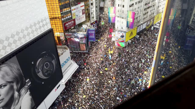 hundreds of thousands of protesters walk down hennessay road during an anti-extradition bill march on july 21, 2019 in hong kong, china.... - hong kong stock videos & royalty-free footage