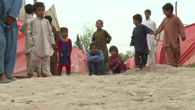 hundreds of thousands of residents displaced by conflict in pakistan's tribal areas dream of one thing going home - indigenous culture stock videos & royalty-free footage