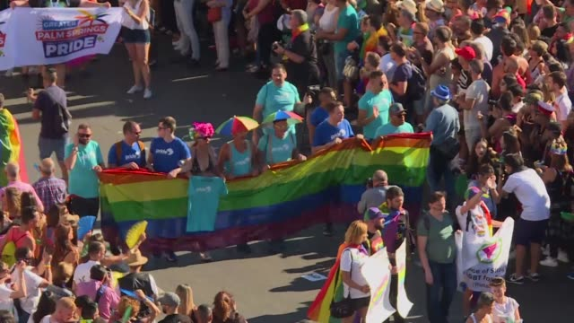 hundreds of thousands of revellers young and old took to the rainbow streets of madrid saturday in the world's biggest march for gay lesbian bisexual... - bisexuality stock videos and b-roll footage