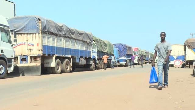 hundreds of trucks filled with thousands of tons of coffee from ivory coast the third largest african producer are still blocked on thursday at the... - côte d'ivoire stock videos & royalty-free footage