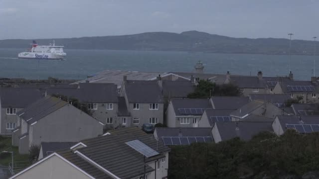 stockvideo's en b-roll-footage met hundreds of trucks roll off the docks at holyhead every day bringing goods to and from ireland and an economic lifeline for this deprived corner of... - clean
