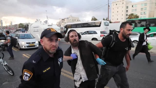 hundreds of ultra orthodox jews battled israeli police near tel aviv and in jerusalem on monday with 33 people arrested in the latest protests... - israel stock videos & royalty-free footage