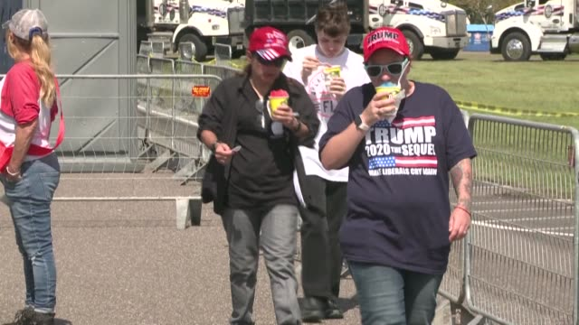 stockvideo's en b-roll-footage met hundreds of us president donald trump's supporters gather at a military airport near jacksonville, florida ahead of a presidential campaign rally in... - clean