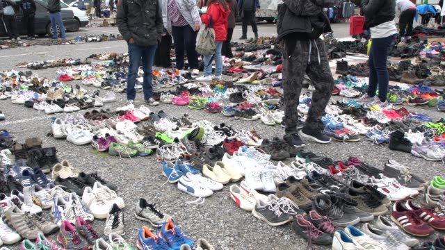 Hundreds of used cheap footwear for sale at an exotic flea market