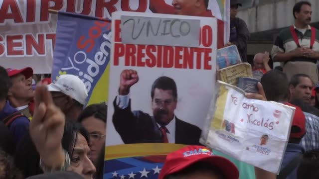 hundreds of venezuelans many wearing red take to the streets of caracas to support the government of nicolas maduro - maduro stock videos & royalty-free footage