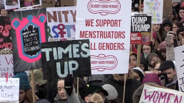hundreds of women and men march outside parliament to protest for women's equality. interviews with jade slaughter, author francesca simon, avril... - moving activity stock videos & royalty-free footage