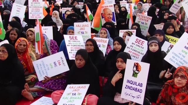 hundreds of women many armed with the indian flag gather at agripada in mumbai to protest against the citizen amendment act caa a bitterly disputed... - flag of bangladesh stock videos & royalty-free footage