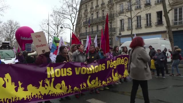 hundreds of women marched through paris on the occasion of international women's day - marching stock videos and b-roll footage