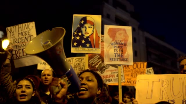 hundreds of women took part in the women's march in front of the us embassy in athens, raised placards and shouted slogans against donald trump and... - women's rights stock videos & royalty-free footage