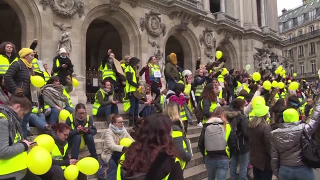 vídeos de stock, filmes e b-roll de hundreds of women wearing yellow vests took to the streets of paris on sunday a day after 50000 turned out and some protesters smashed their way into... - vest