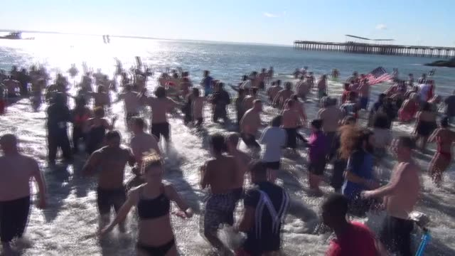 Hundreds sprint into Atlantic Ocean on January 1st to wash out the old and bring in the new year