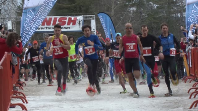 hundreds start snowshoe race in saranac lake ny - salmini stock videos and b-roll footage