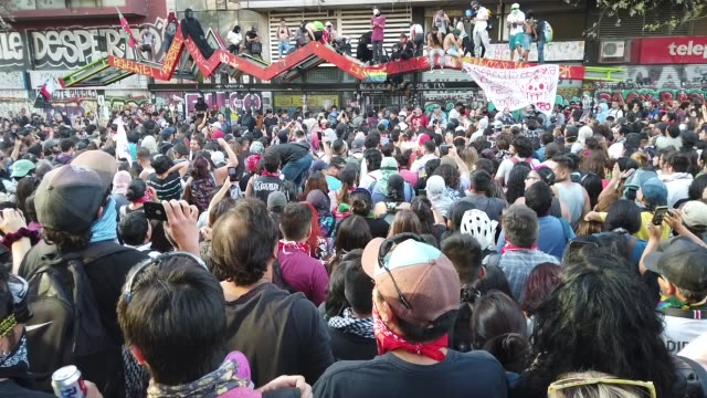 hundreds take to the streets in santiago de chile to protest against the right-wing government of sebastian pinera and to support extensive social... - reform stock-videos und b-roll-filmmaterial