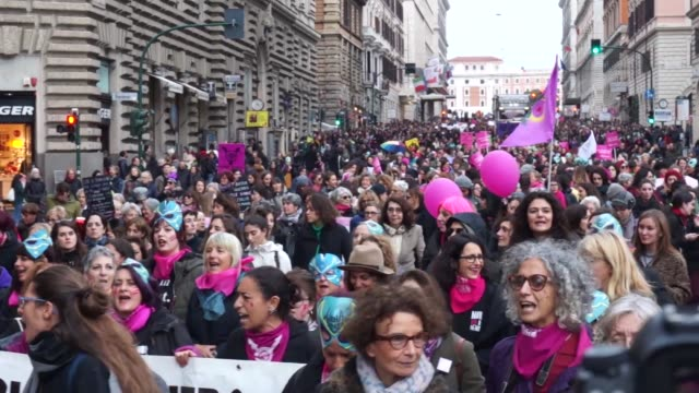 hundreds take to the streets of rome to protest violence against women on november 23 - violence stock videos & royalty-free footage